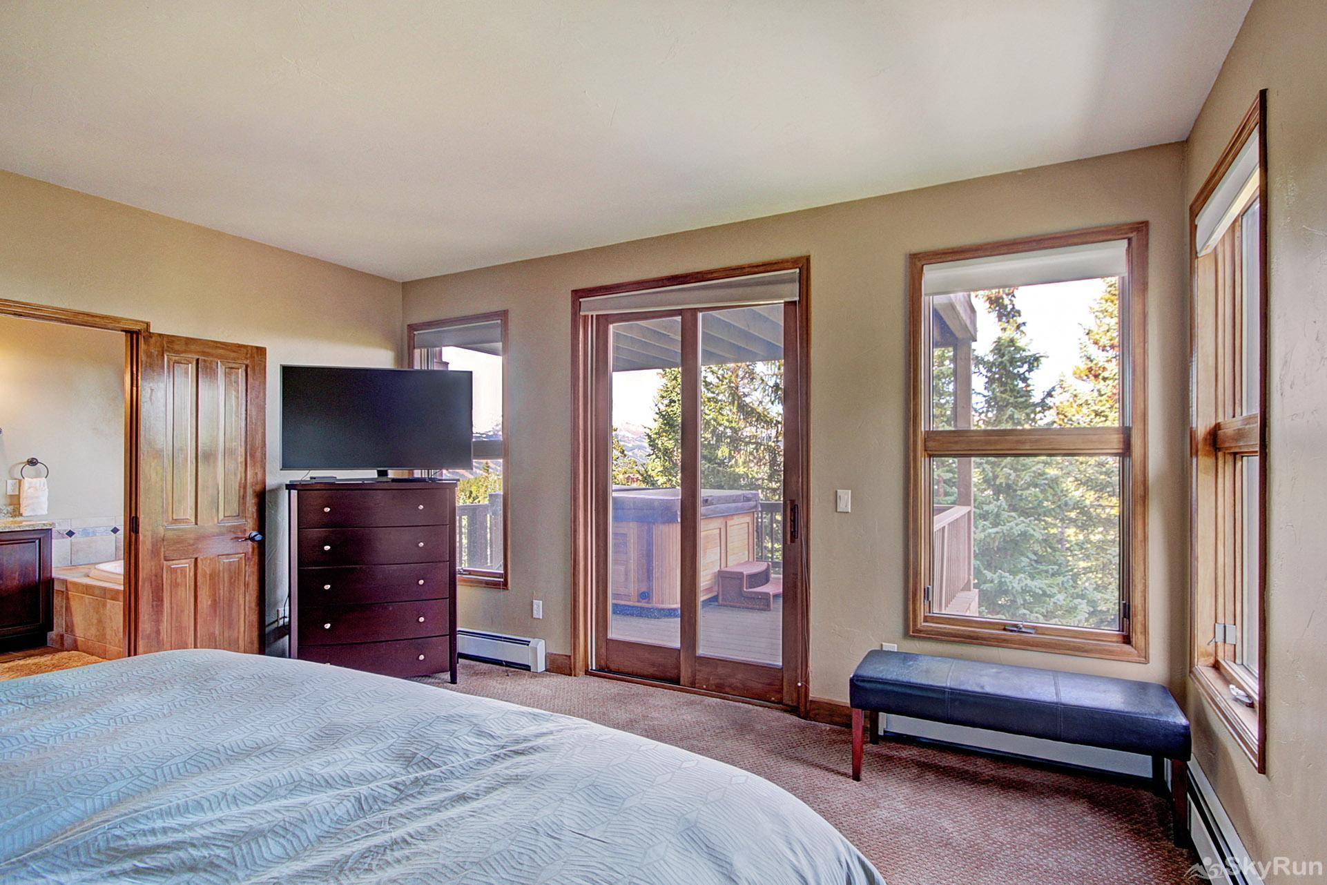 Big View Lodge King master bedroom - access to hot tub on middle deck