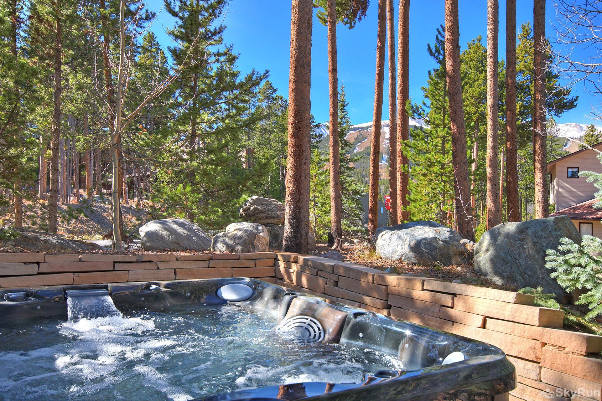 Wildernest Point Private outdoor hot tub with wooded backdrop