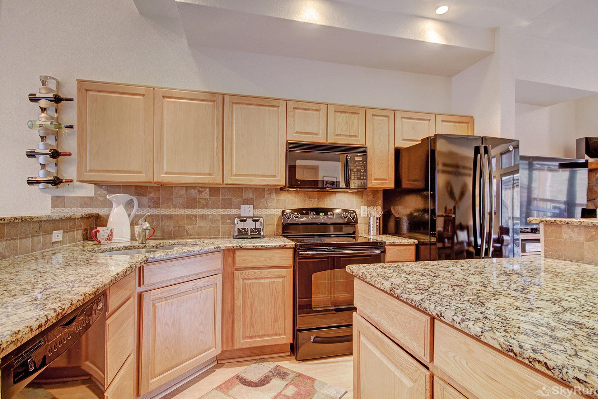 Village Point 303 Modern kitchen features beautiful granite countertops