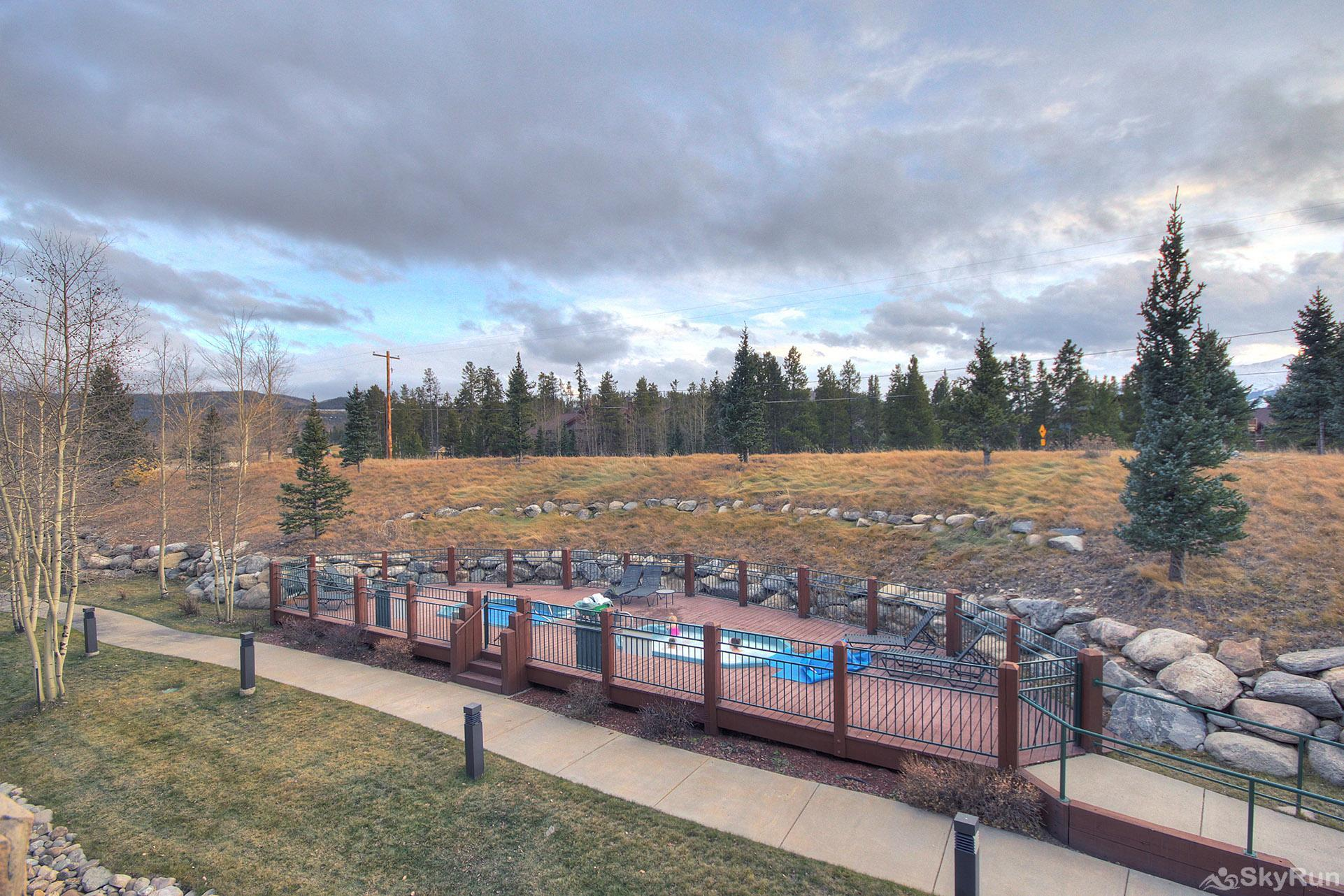 Highland Greens Lodge 211 Private deck overlooks hot tubs and offers scenic views of the 10-Mile Range