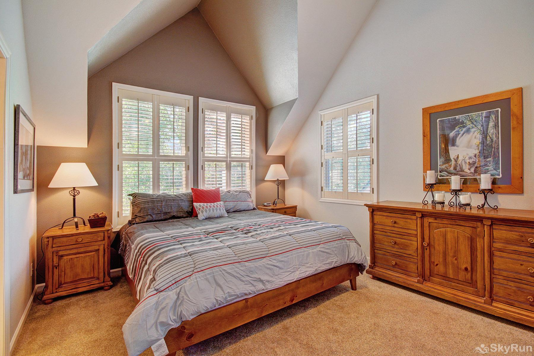 Bear Pine Chalet Upper level king master bedroom with en suite bath and flat screen TV