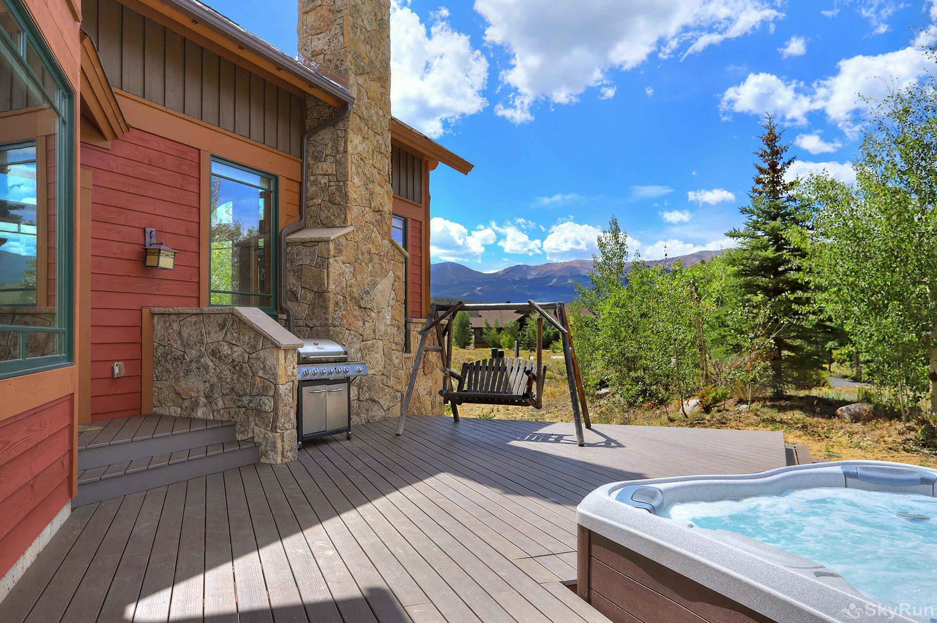 Buffalo Lodge Private outdoor patio with hot tub and propane grill