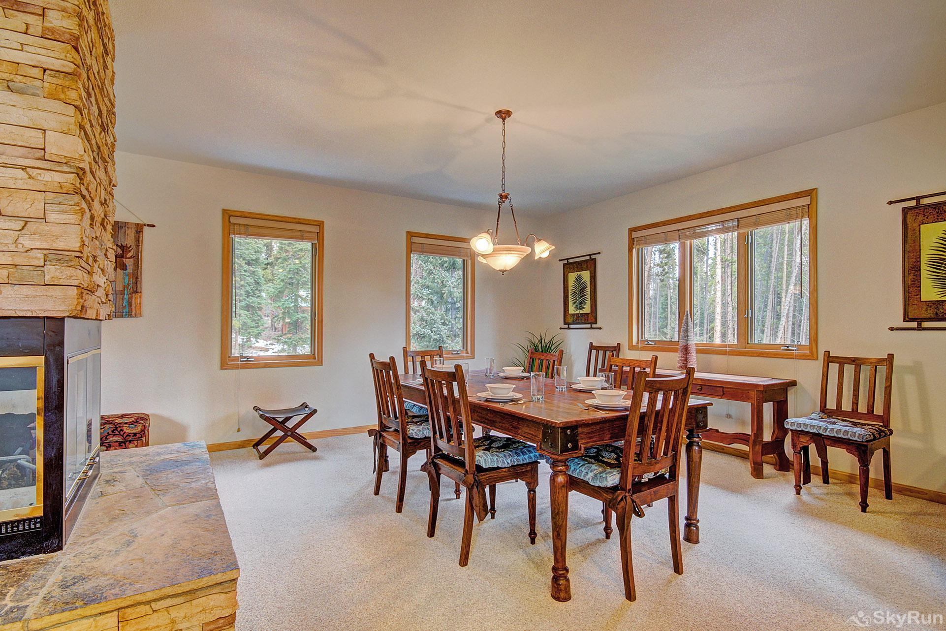 Secret Trail Lodge Dining table with seating for 8, additional seating for 3 at bar