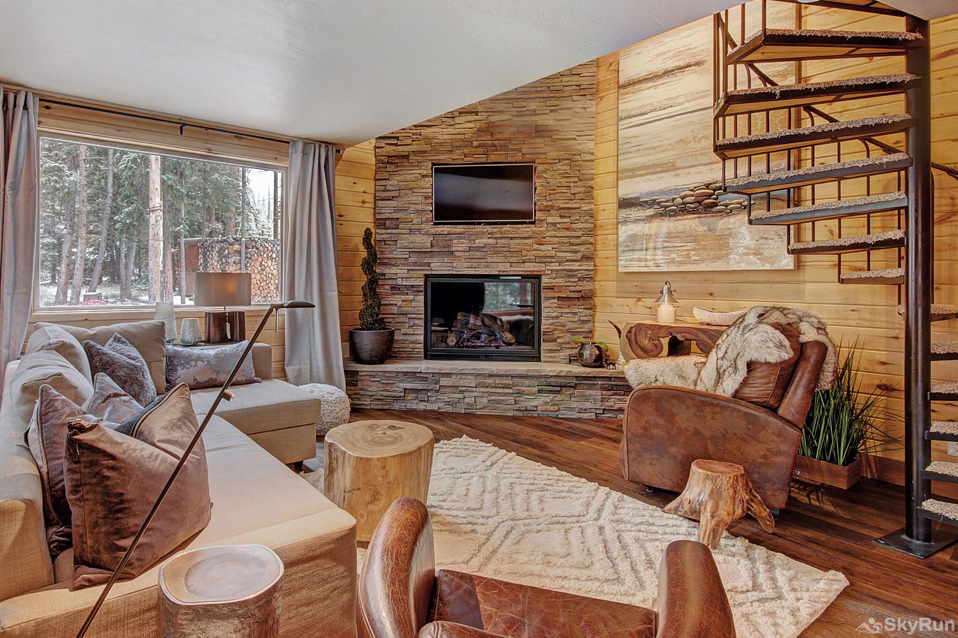 Riverhaus Cozy living room with gas fireplace and flat screen TV
