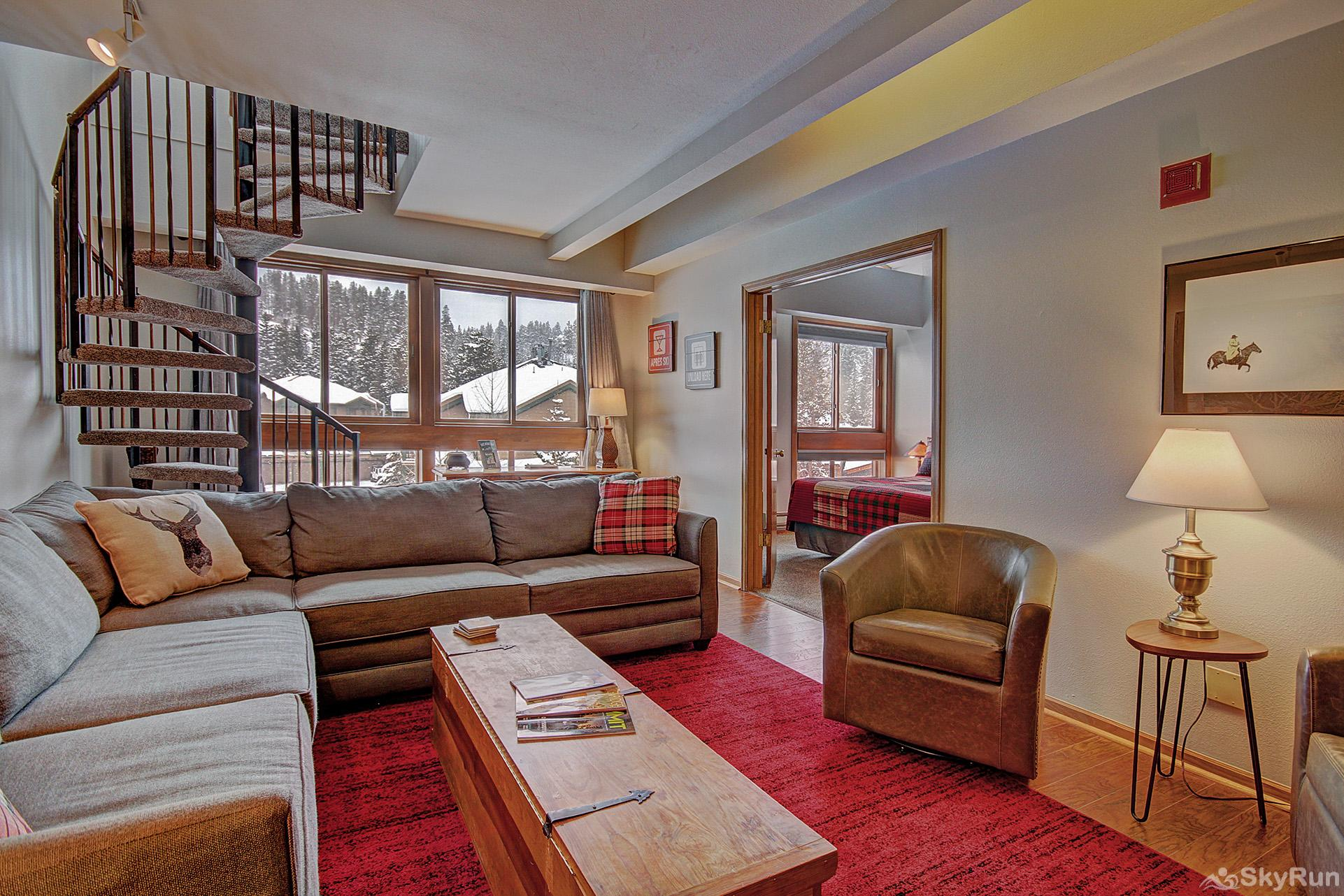 Ski Hill 22 Living area with spiral staircase to upper level
