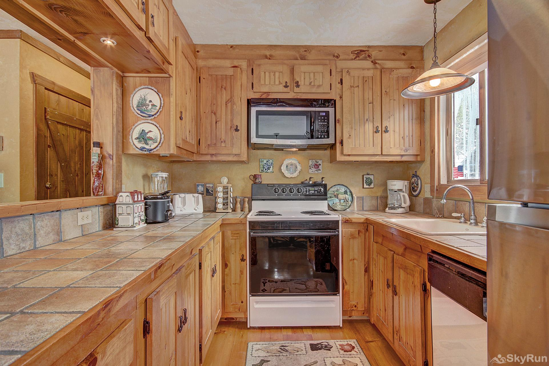 Whispering Pines Enjoy home cooked meals with the convenience of a fully equipped kitchen