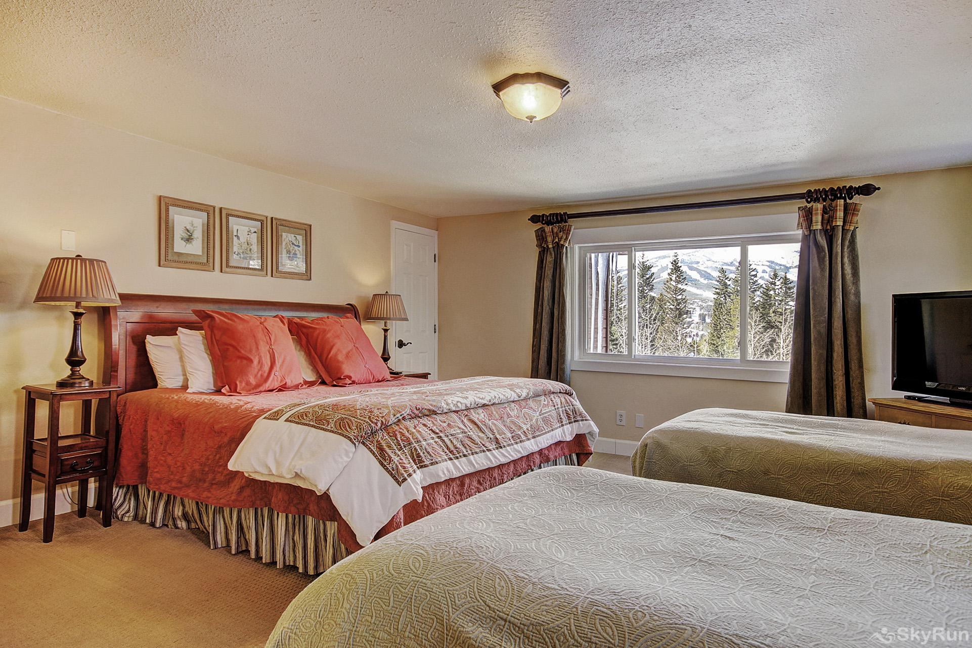 High Point Chateau Upper level king bedroom with 2 twin beds