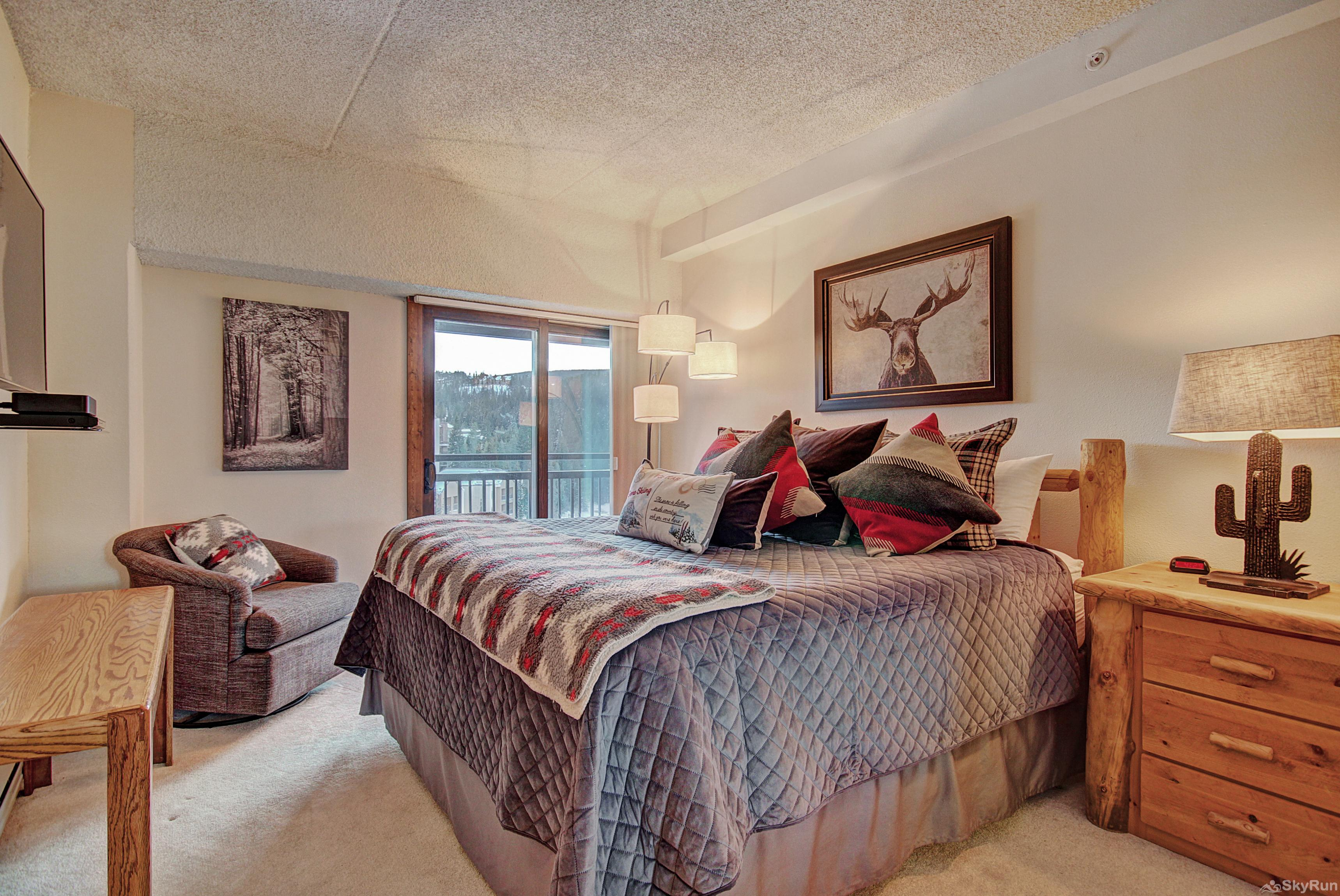Village at Breck Antero 1503 King master bedroom with walk-out balcony, ensuite bath