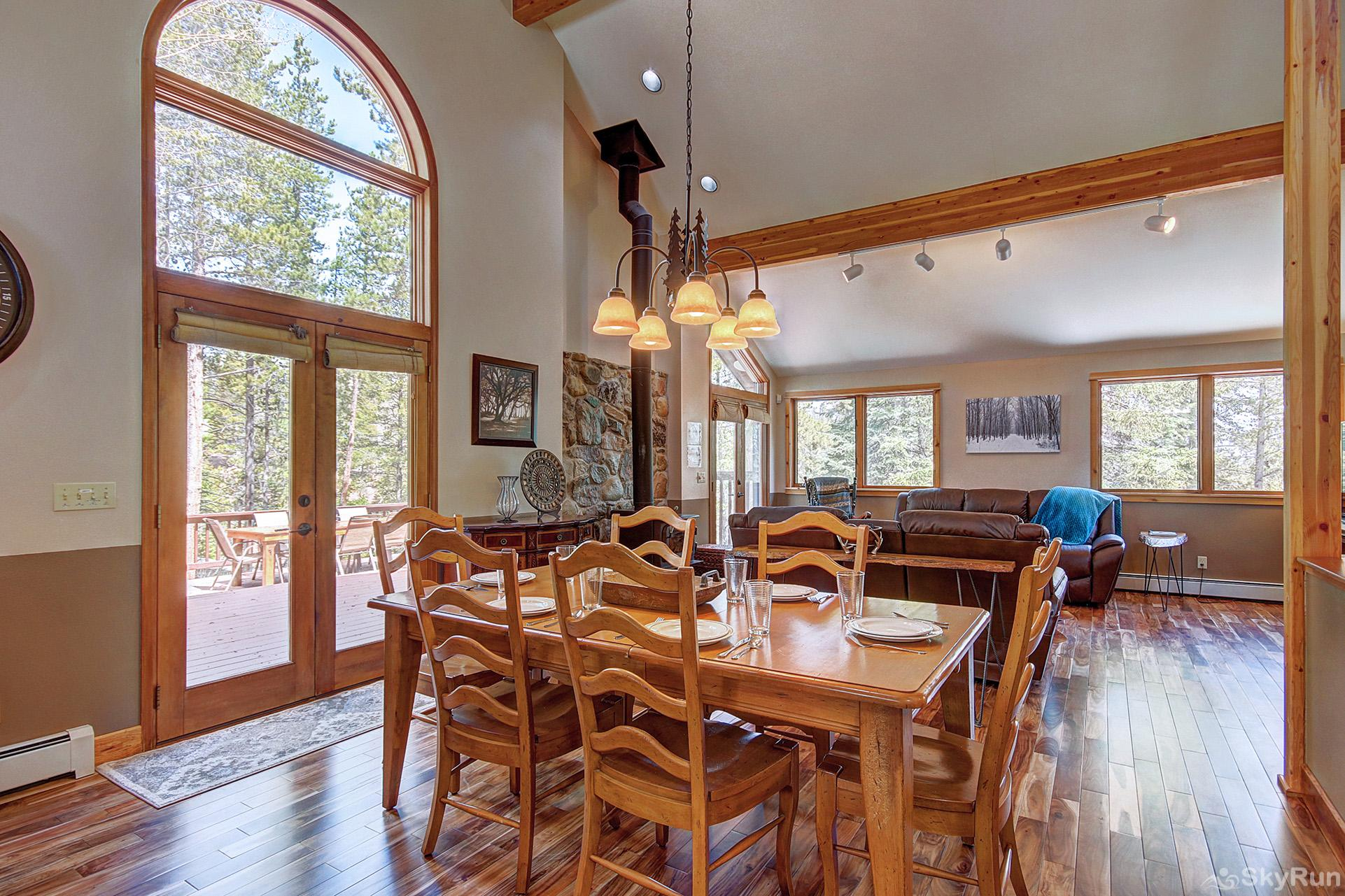 Aspen Heights Lodge Dining table and main level living room area