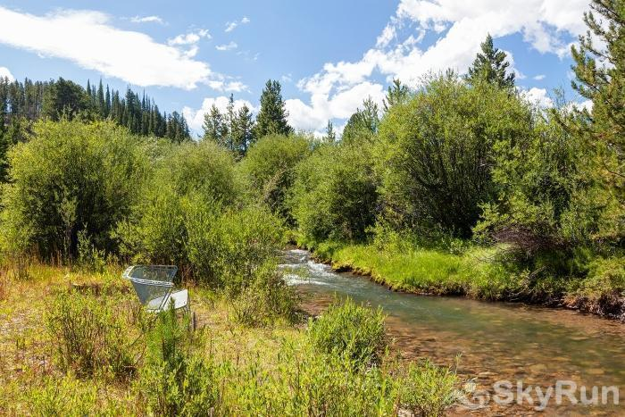 Swan River Retreat Stream running thru the property!  **NOT ACCESSIBLE IN WINTER**