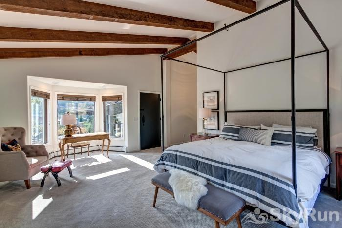 Mountain View Chalet Spacious master bedroom with views of the slopes!