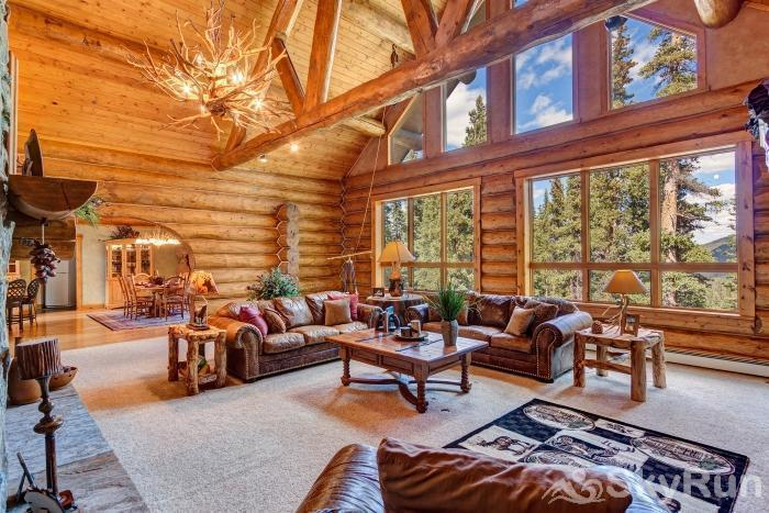 Pine Forest Lodge Beautiul picture windows and vaulted ceilings in the Living Room