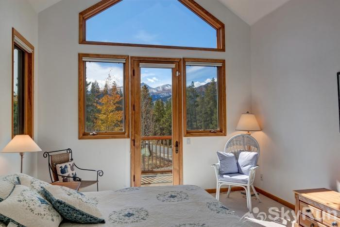 Ten Mile Lodge Large bedroom windows looking out to gorgeous alpine scenery