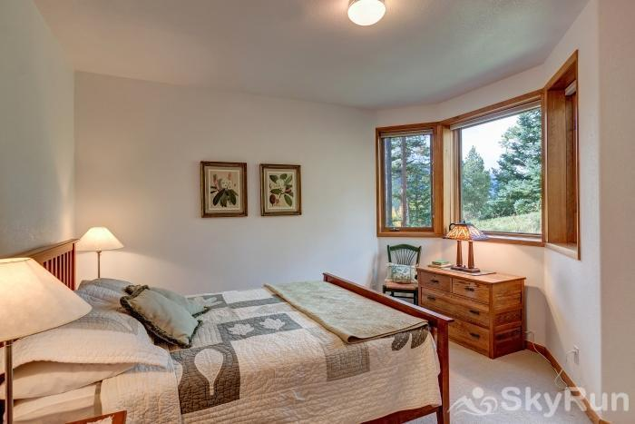 Ten Mile Lodge Queen bedroom with large windows