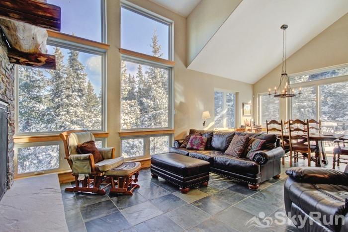 Twin Creek Lodge Spacious living area featuring vaulted ceilings and large windows