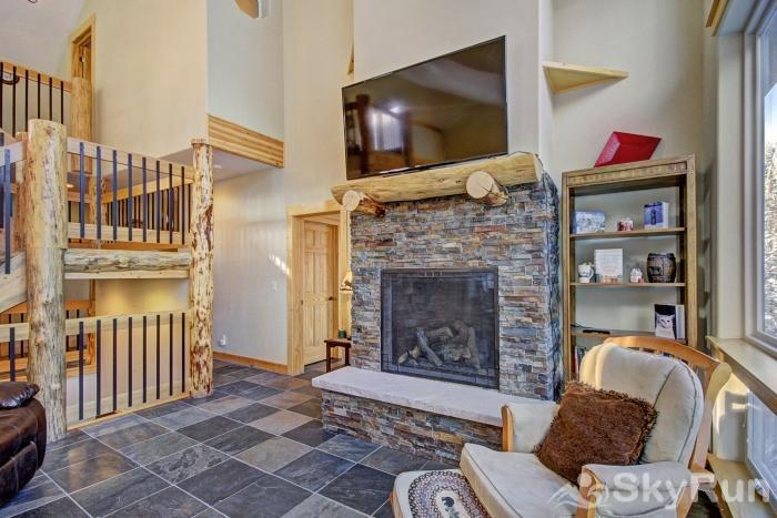 Twin Creek Lodge Stay warm and cozy by the gas fireplace while enjoying a movie on the flat screen tv!