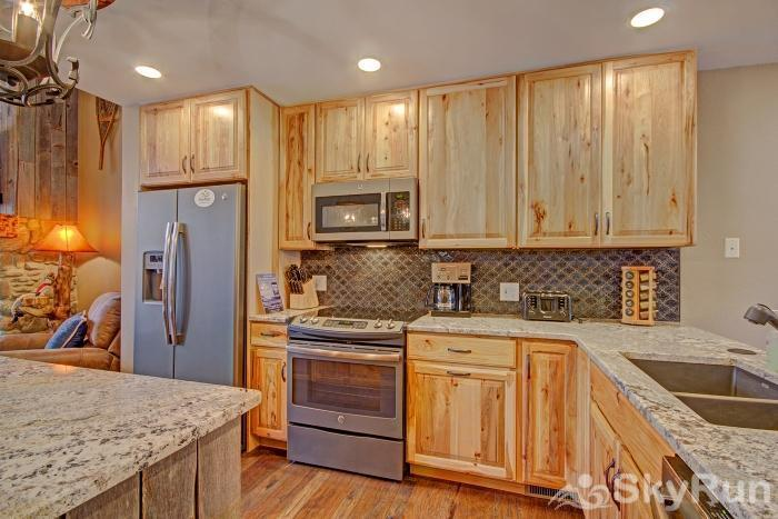 Village Point 109 Fully equipped kitchen with full size fridge & dishwasher