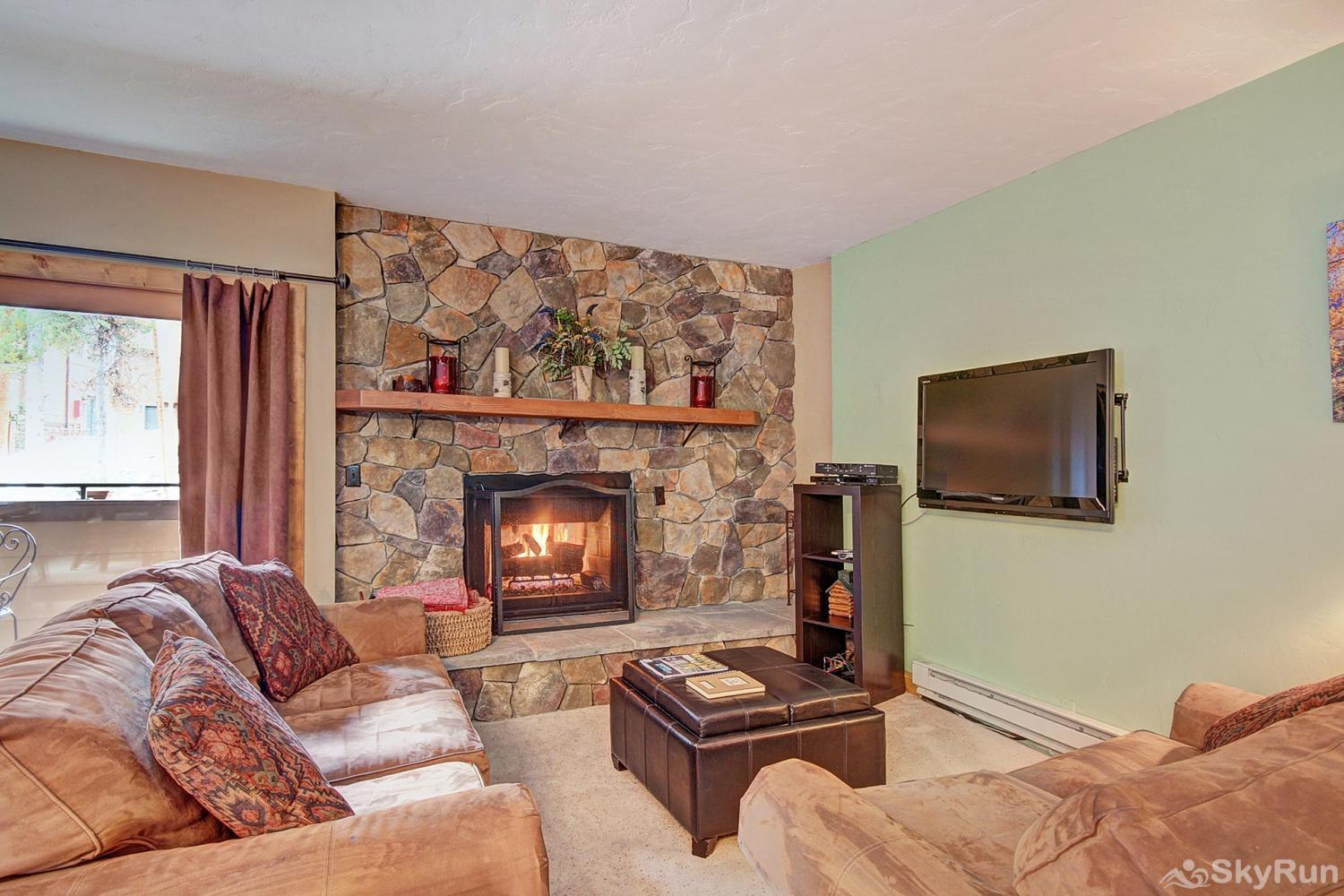 Sundowner II 201 Alternate view of living room with flat screen TV and gas fireplace