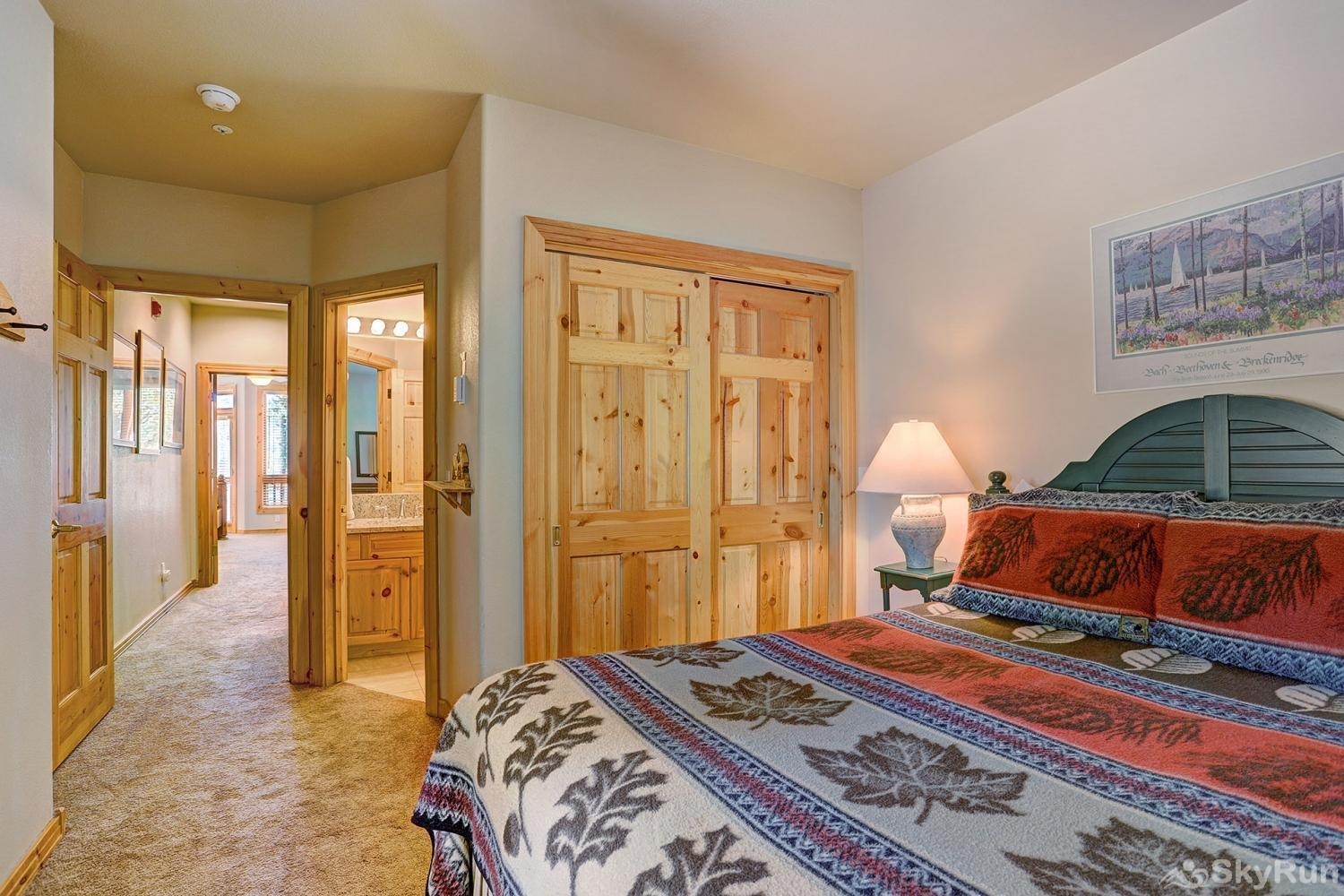 Elk Ridge Retreat Cozy queen bedroom with ensuite bath