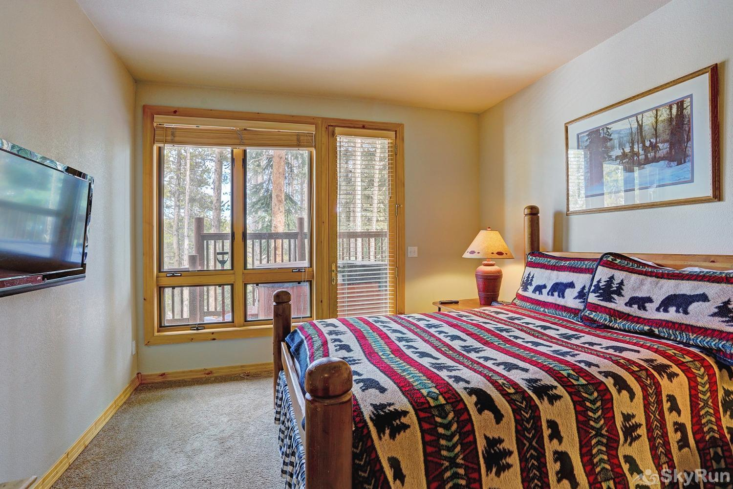 Elk Ridge Retreat Third bedroom with queen size bed & plenty of natural light