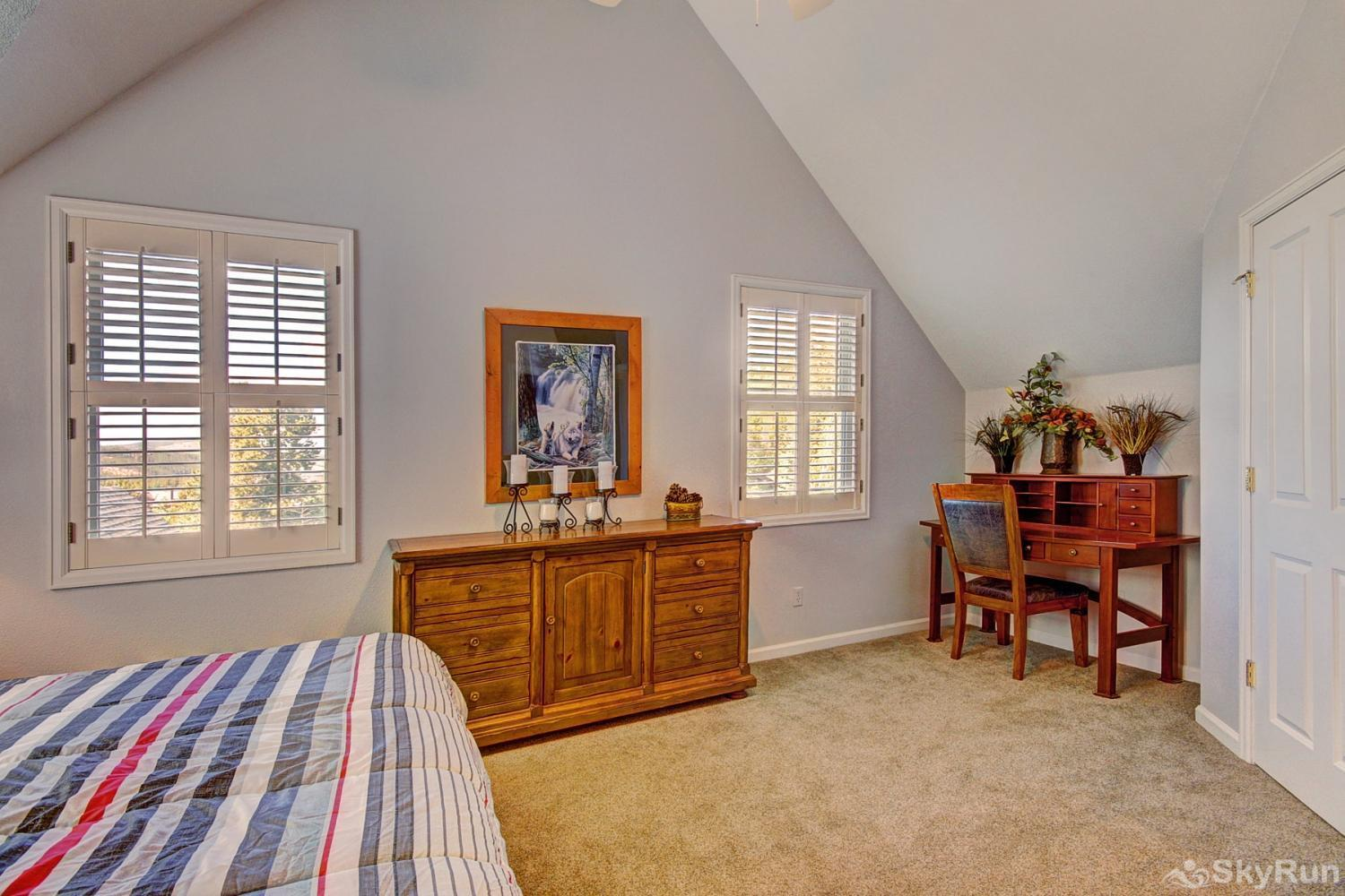 Bear Pine Chalet Spacious master bedroom with desk for added convenience
