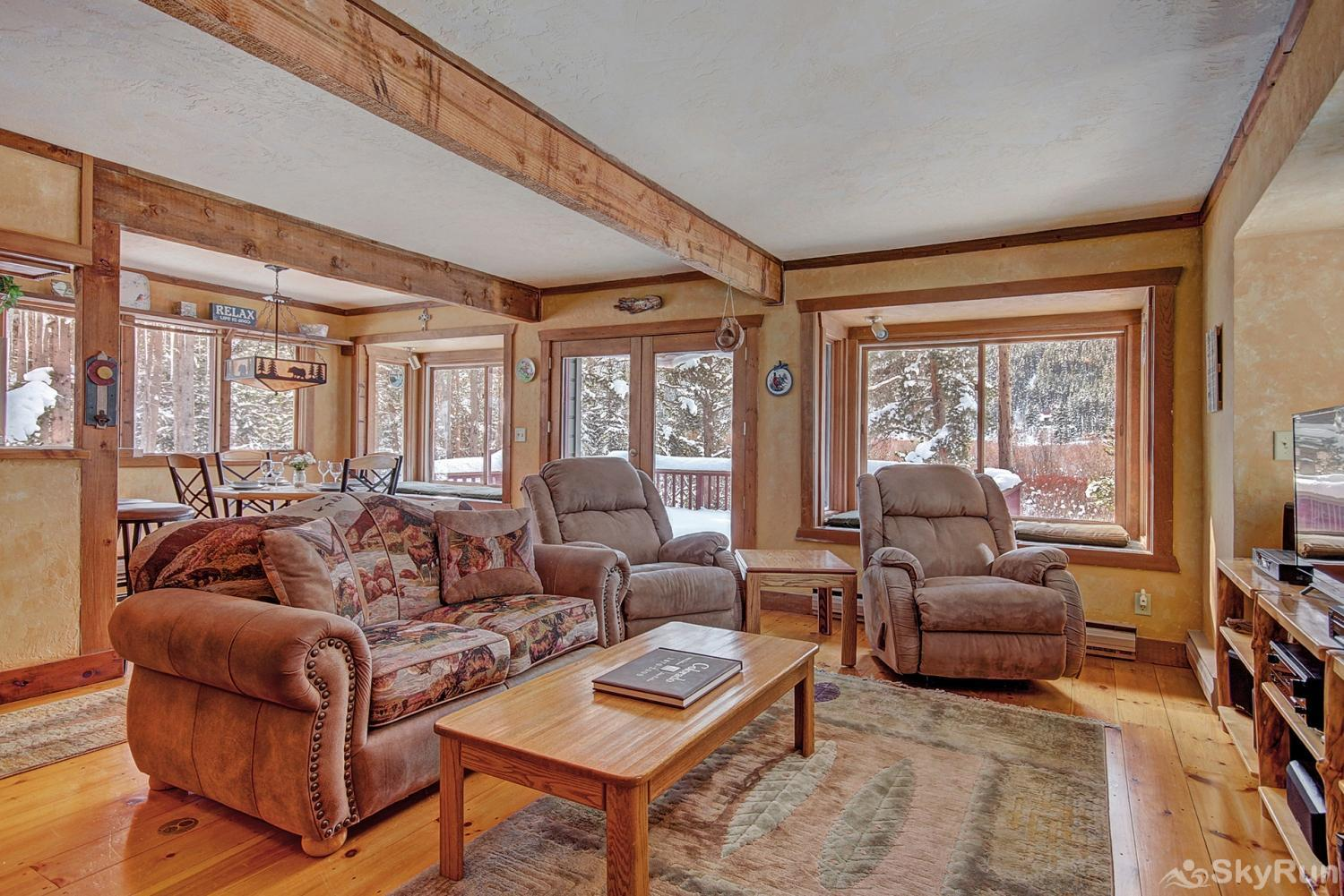 Whispering Pines Large windows provide plenty of natural light