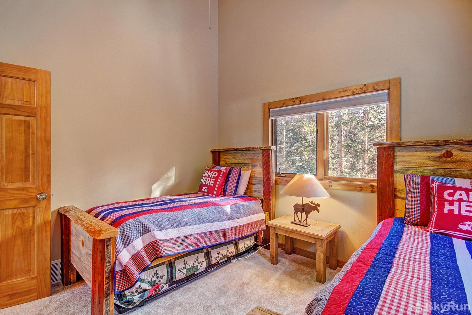 The Sly Fox Hideaway Upper level bedroom with 2 twin beds and additional twin trundle bed