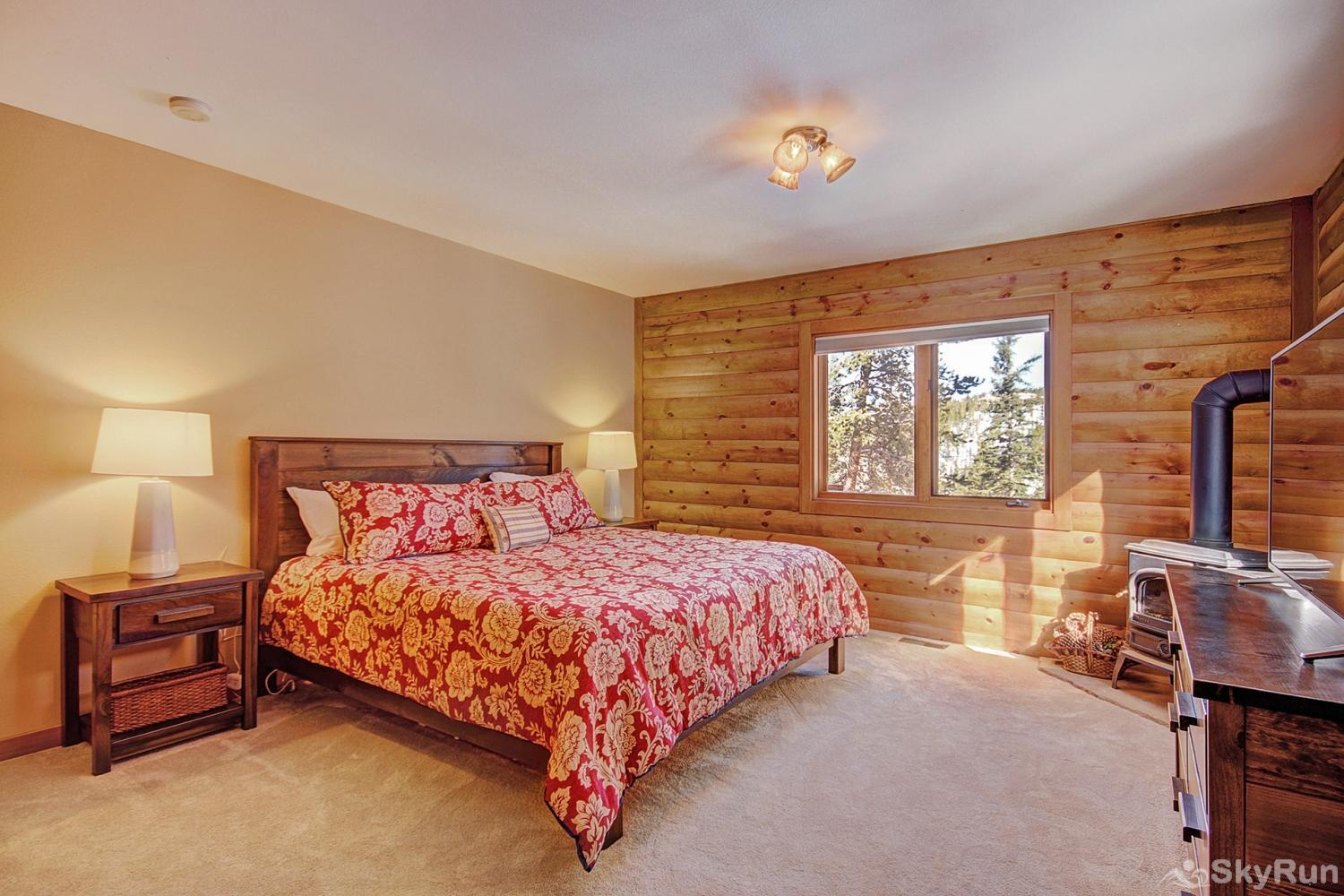 The Sly Fox Hideaway Main level king master bedroom with flat screen TV, fireplace & ensuite bath