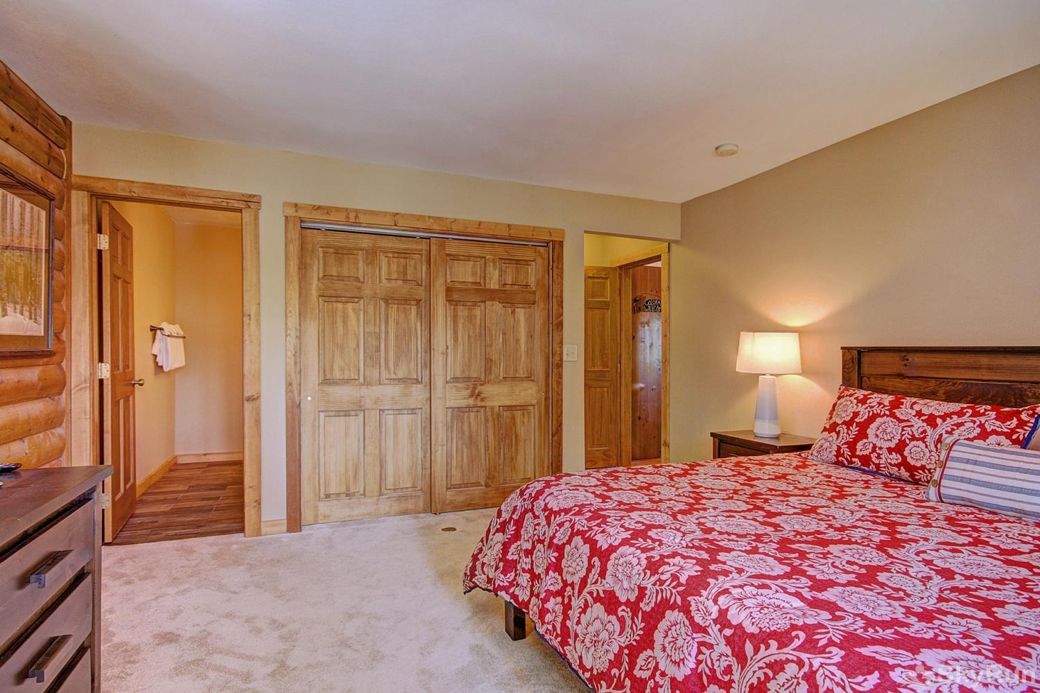 The Sly Fox Hideaway Main level king bedroom with ensuite bath
