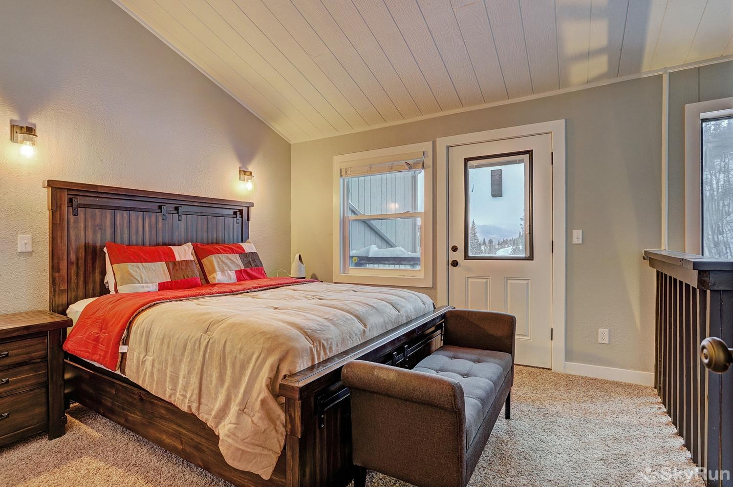 Knotty Pine Lodge Second queen bedroom with private balcony, reading nook