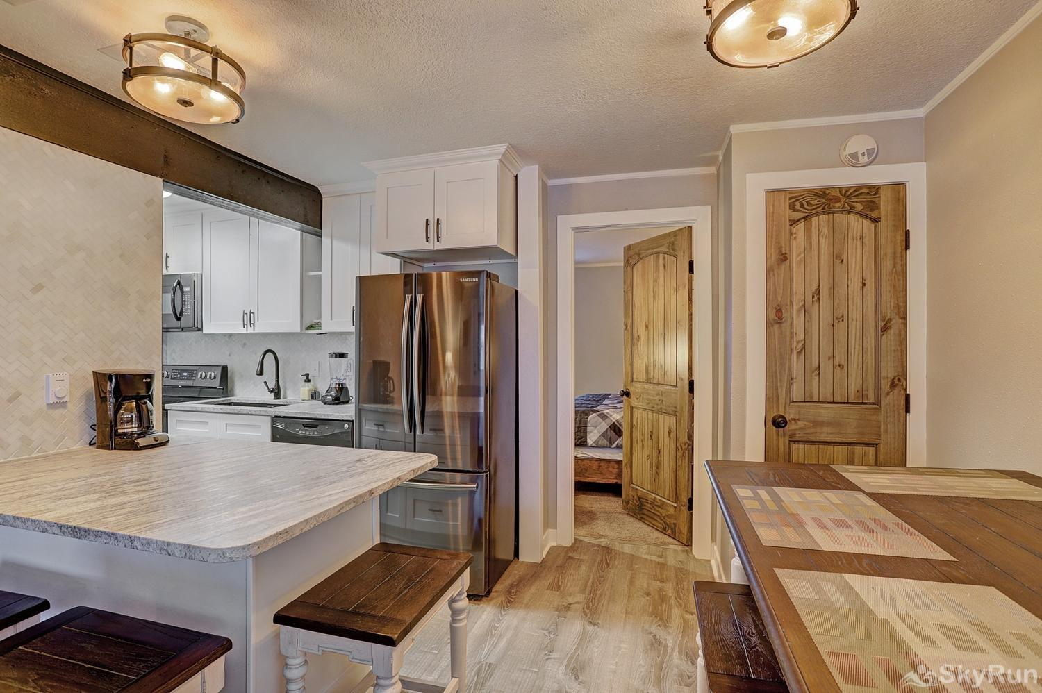 Knotty Pine Lodge Kitchen and dining area with counter top seating